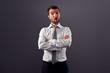surprised businessman over grey background
