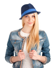 Portrait of young woman in blue hat