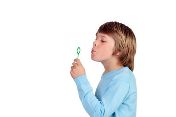 Adorable preteen boy blowing for make bubbles