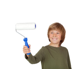 Adorable child with a paint roller
