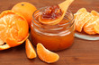 tasty homemade mandarine jam, on wooden table