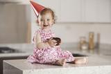 Cute baby girl celebrating her birthday with cake