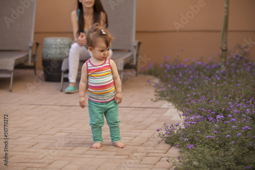 Beautiful baby girl and her mom spending time outdoors