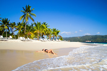 woman relaxes on beach