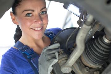 Car mechanic repairs the brakes