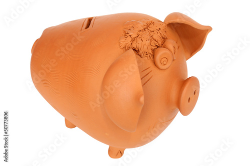 Earthen pig money-box isolated on white backgrund