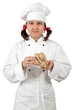 Woman chef in uniform isolated . Holds a ginger root.