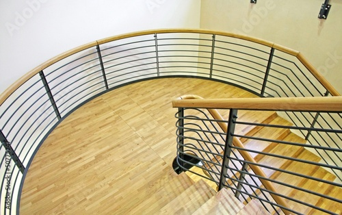 wood spiral staircase with very wide curve