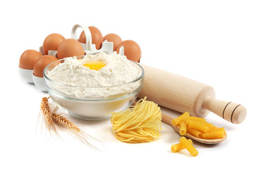 Bakery ingredient. Flour with raw eggs for making dough isolated