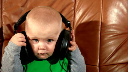 Baby listening to music in headphones