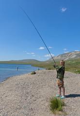 Boy fishing on spinning