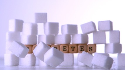 Wall of sugar cubes with dice spelling out diabetes