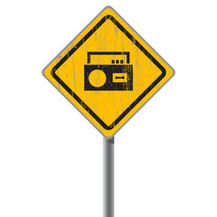 Old shabby yellow sign with an old-fashioned cassette recorder.