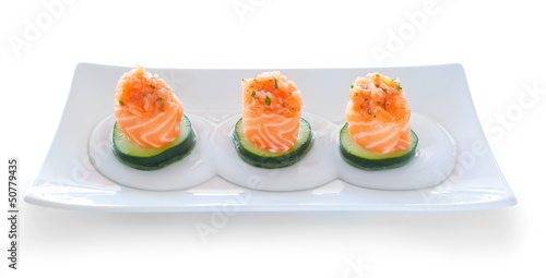Three servings of sushi salmon and cucumber filling. On a platte