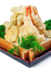 Fried calamari with parsley and dill in a decorative wooden plat