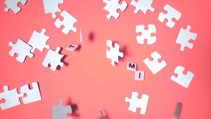 Letters bouncing and spelling out autism next to jigsaw puzzle