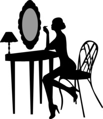 Girl makes make-up in front off mirror silhouette