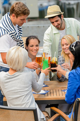 Group of cheerful people toasting with cocktails