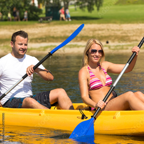 Couple sitting in kayak on a sunny day