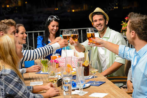 Group of young friends drinking beer outdoors