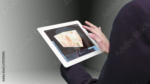 Woman using tablet to view holographic education videos