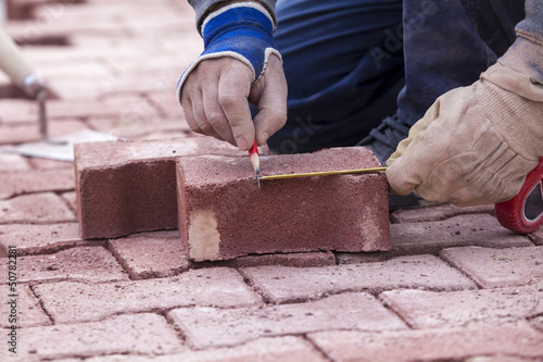 marking with a pencil on a brick paver, before CUTTING