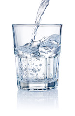Water pouring into glasses isolated on a white background