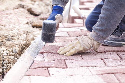 Paver bricks settings by rubber hammer