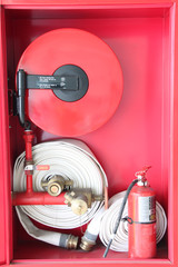 Firefighting equipment in the cabinet.
