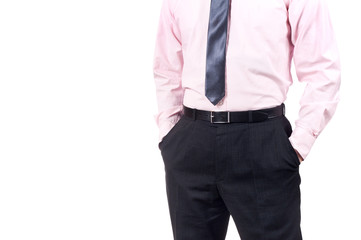 Well dressed man standing with his hands in the pockets isolated