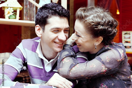Young Smiling Couple in Cafe