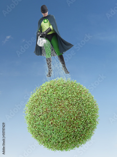 Eco superhero watering green planet