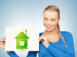 woman with illustration of green eco house