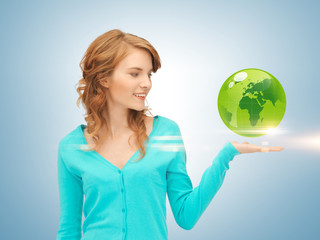 woman holding green globe on her hand