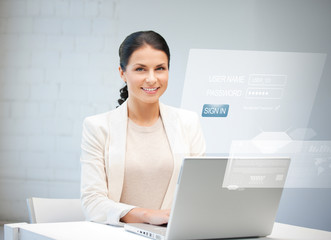 woman with laptop computer and virtual screen