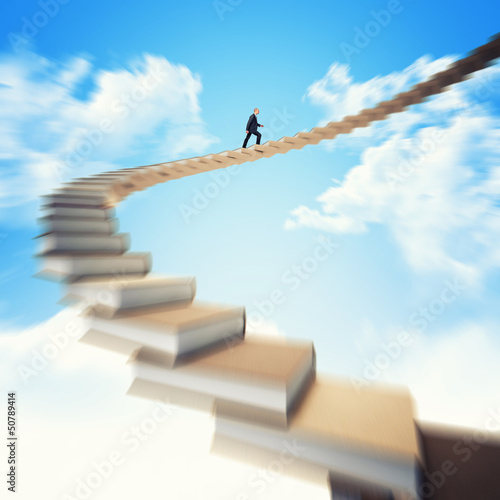 man on books stair