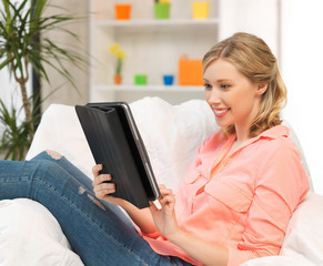 woman with tablet pc computer or touchpad indoors