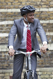 Portrait of African American businessman riding Bicycle