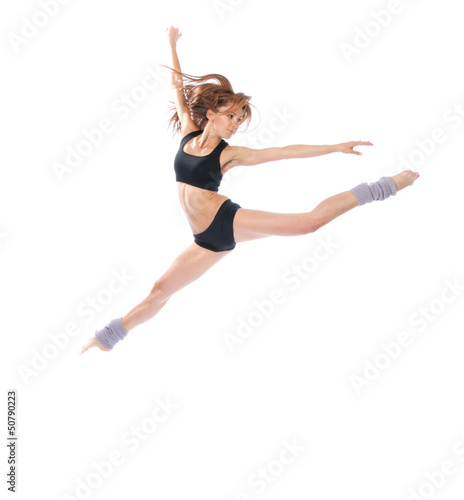 modern slim stylish teenage girl jumping dancing