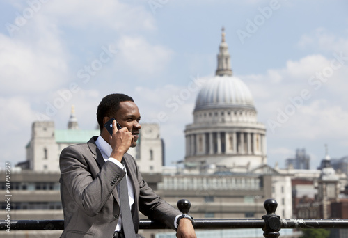Portrait of African American businessman talking on Cell phone in London