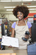 Portrait of an African American female store clerk standing at checkout counter
