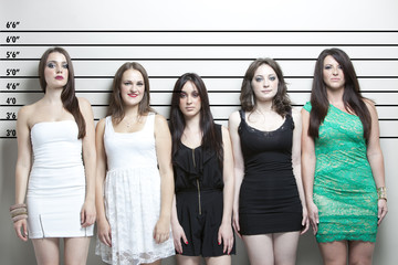 Portrait of five young women in a police lineup