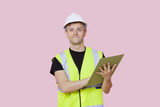 Portrait of a male construction worker with clipboard over pink background