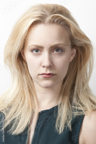 Portrait of young Caucasian woman against white background