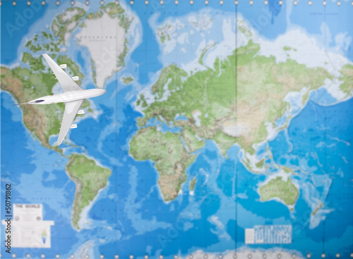 Model airplane flying over world map