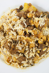 Close-up of rice and meat in plate
