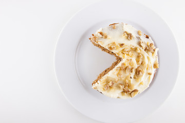 Walnut cake in plate over white background