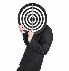 Buisiness man holding dartboard