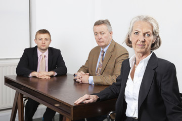 Portrait of confident business group at desk in office