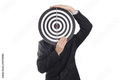 Buisiness man holding dartboard